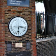 Stock Photo: Clock near prime meridian.