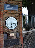 Clock near prime meridian. — Stock Photo