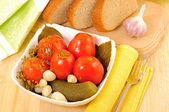 Tomatos, cucumber with garlic, dill and bread. — Stock Photo