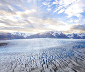 Grey glacier at sunset. — Stock Photo