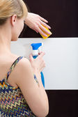 Woman washes a tile with clearing means — Stock Photo