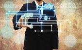 Businessman scanning of a finger on Grunge background — Stock Photo