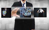 Businessman holding Reaching images streaming in hands — Stock Photo