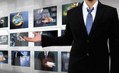 Businessman holding Reaching images streaming in hands . — Stock Photo