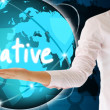 Stock Photo: Holding creative in his hand , creative concept