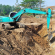 Excavator loader machine with risen boom construction site — Stock Photo