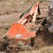 Stock Photo: Tractor with cultivator prepares field for seeding.