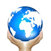 Hand holding globe to protect the fragile environment — Stock Photo