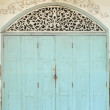 Old painted blue door on the whitewashed wall. Background. — Stock Photo #28324853