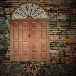 Front doors of an old brick building — Stock Photo