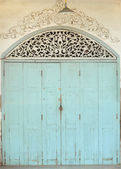 Old painted blue door on the whitewashed wall. Background. — Stock Photo