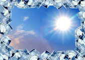 Ice cubes frame in blue sky — Stock Photo