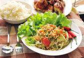 Somtum Thai food and spicy food on a white dish — Stock Photo