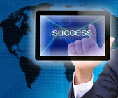 Businessman hand pressing success button on a touch screen interface — Stock Photo
