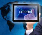 Businessman hand pressing contact button on a touch screen interface — Stock Photo