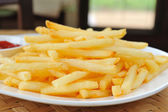 French fries in a white plate — Stock Photo