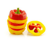 Sliced red and yellow pepper isolated on white — Stock Photo