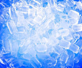 Background with ice cubes in blue light — Stock Photo