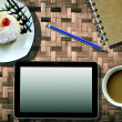 Coffee cup notebook and Tablet Computer on bamboo — Stock Photo #28430435