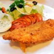 Fried fish and salad — Stock Photo