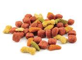 Dry dog food on white background. — Stock Photo