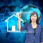 Businesswoman hand writing house — Stock Photo #28587343
