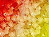 Red yellow ice cubes — Stock Photo
