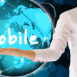 Stock Photo: Holding mobile in hand , creative concept