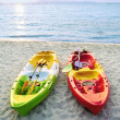 Stock Photo: Canoes on beach.