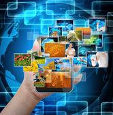 手持移动智能电话与世界技术背景 — 图库照片