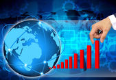 Hand pulling up a bar from a graph on abstract the world business — Stock Photo
