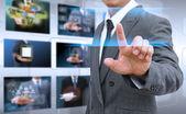 商人手按触摸屏界面上的按钮 — 图库照片