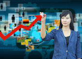 Businesswomen hand writing rising arrow — Stock Photo