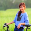 Beautiful Girl on Bike in Countryside — Stock Photo