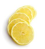 Skivor av citron på vit bakgrund — Stockfoto