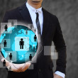 Businessman holding business world — Stock Photo
