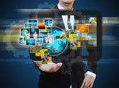 Businessman holding Reaching images streaming in hands .Financia — Stock Photo