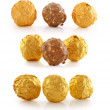 Sweet chocolate candy wrapped in golden foil isolated on white b — Stock fotografie