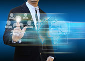 Businessman touch icon of social network — Stock Photo