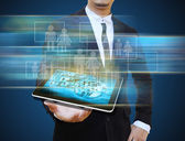 Businessman holding tablet — Stock Photo
