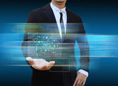 Businessman holding social network icons. — Stock Photo