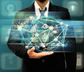 Businessman holding world social network — Stock Photo