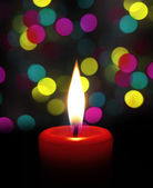 Candle flame at night with bokeh — Stock Photo