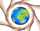 Hands making a circle  Surrounding the Earth — Stock Photo