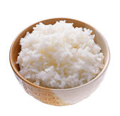 Rice in a bowl on a white background — Stock Photo