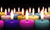 Candle on black background — Stock Photo