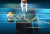 Businessman hand drawing business graph — Stock Photo