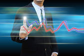 Businessman hand pushing a business graph — Stock Photo