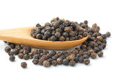 Spoon with Whole Black Pepper Granules — Stock Photo