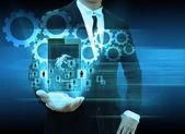 Businessman holding smartphone technology and social media — Stockfoto